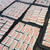 Corporate iced biscuit order for Knight Frank - stencilled