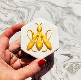 Shimmering gold bees for Guerlain