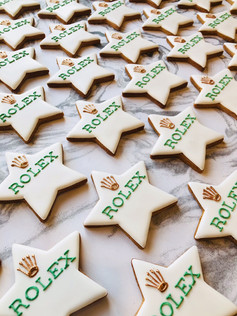Hand iced logo biscuits for Rolex