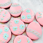 A dozen embroidered egg iced biscuits