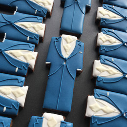 Bespoke Morning suit biscuit favours to complement the grooms outfit