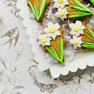 A host of daffodil iced biscuits - a lovely seasonal gift