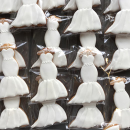 Bespoke wedding dress biscuit favours to match the brides!