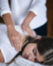 Vertical image of female Reiki therapist