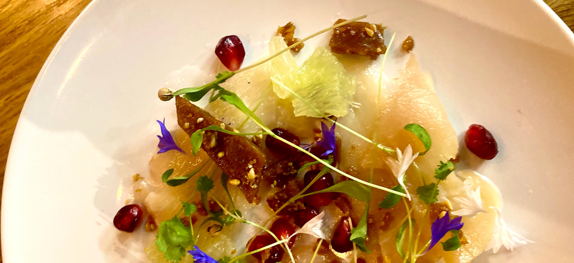 Hamachi Crudo with Pomegrantes, Lime, and Sesame Seed Brittle