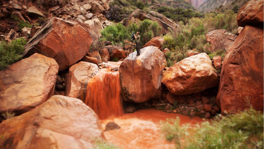 Grand Canyon Pim filming in muddy stream 2.png