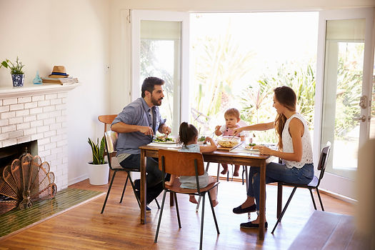 family-enjoying-meal-at-home-together-PF
