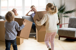 rear-view-kids-playing-with-boxes-moving