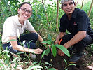 Yesenia Fallas of Swiss Travel planting her own cacao tree