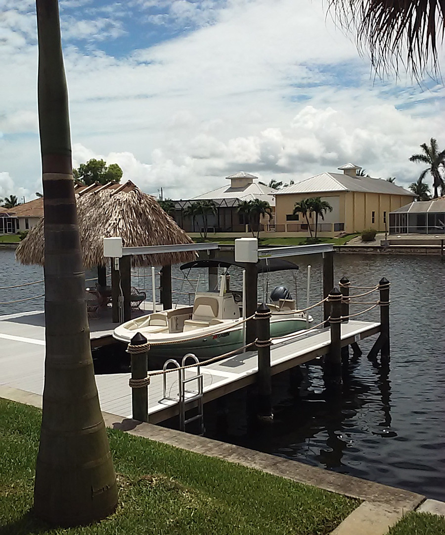 This is a vertical lift with a wrap around dock feturing a tiki hut and ladder
