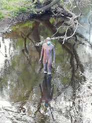 Antony Gormley Statue on Water of Leith