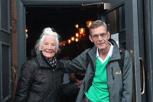 Mary Moriarty and Paul from Invisible Cities in the doorway of the Port of Leith pub