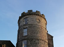 Looking up to a round tower with castellations. Formerly a windmill then signal tower in Leith