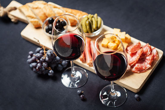Red wine with charcuterie assortment on