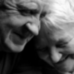 A loving, handsome senior couple on a bl