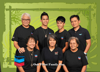Families gather for green screen photos.