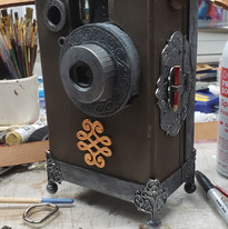 Iconograph prop with functional instant camera installed, from Discworld