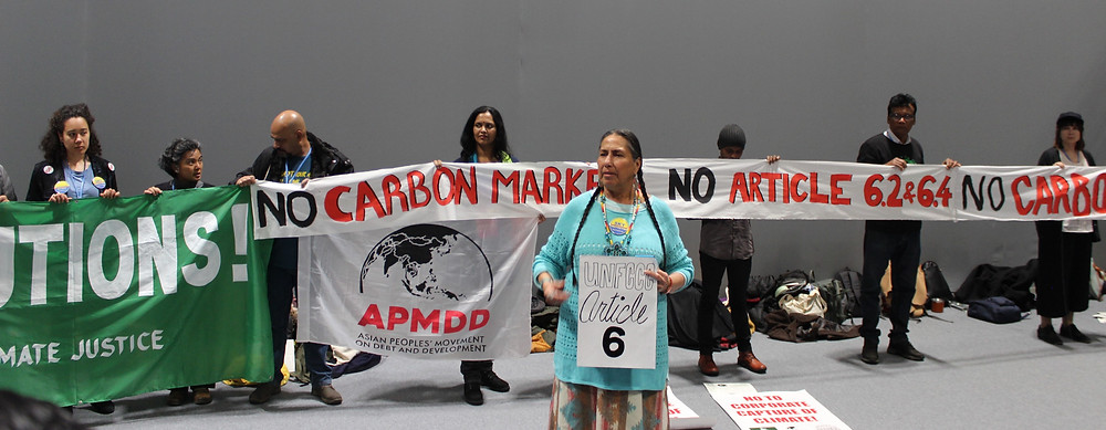 Casey Camp-Horinek speaks at an Article 6 action organized by Indigenous and frontline communities during COP25 demanding an end to carbon markets. Photo via WECAN International - Katherine Quaid