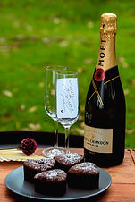 A bottle of moet champagne and 2 champagne glasses together with a note that says; will you marry me?! This marriage proposal setup is decorated and styled at one of the public parks on the Mornington Peninsula.