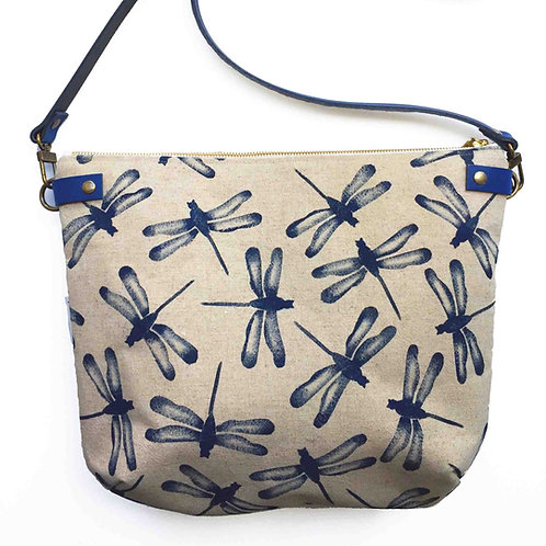 Linen cross body bag with a leather adjustable strap and blue  print