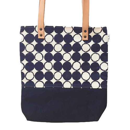 Large canvas tote with leather straps and a blue dots print