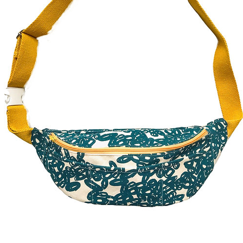 Fanny pack / hip bag with teal coloured abstract doodle print and yellow zipper