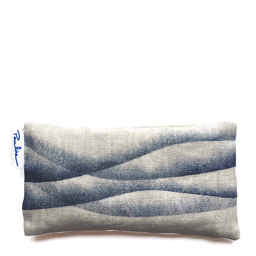 Linen eye pillow filled with flax seed and lavender with blue wave prin