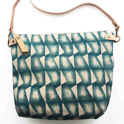 Linen cross body bag with adjustable leather strap tip zipper and teal print