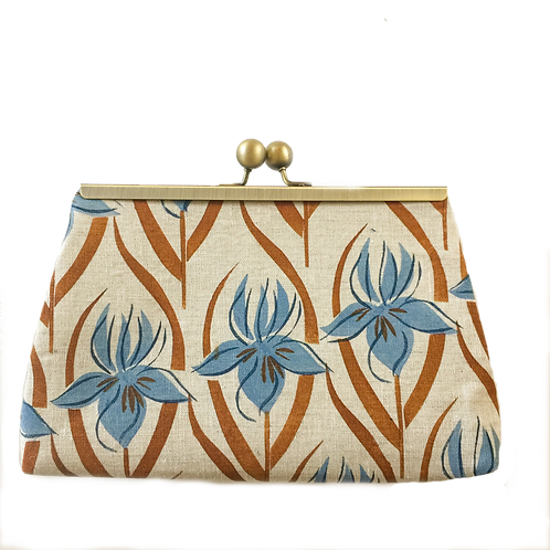 linen frame purse, with iris inspired print in blue and burnt orange