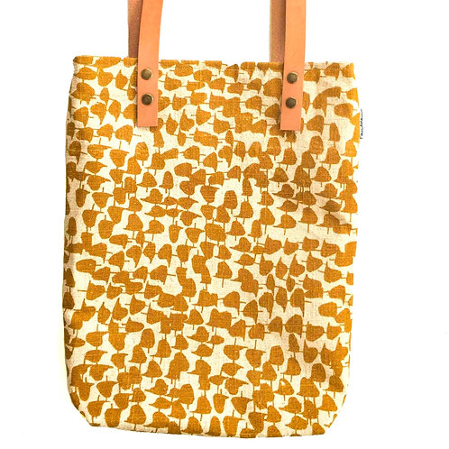 slim linen tote with leather strap and ochre hand screen printed pattern