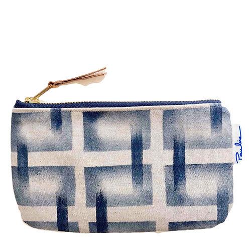Linen zipper pouch with handprinted blue geometrical pattern
