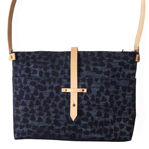 denim shoulderbag with a blue print and an adjustable leather strap