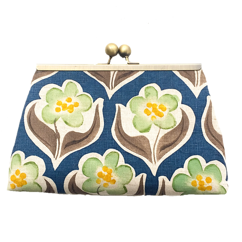 Frame purse green flowers on blue background
