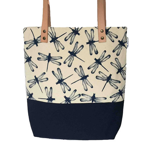 Large canvas tote with leather straps and a blue dragonfly print