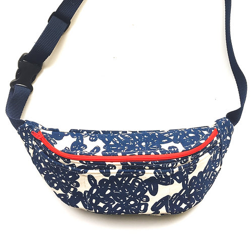 Fanny pack with abstract blue doodle print and orange zipper