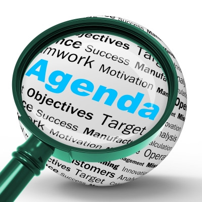 Magnifying Glass looking at agenda