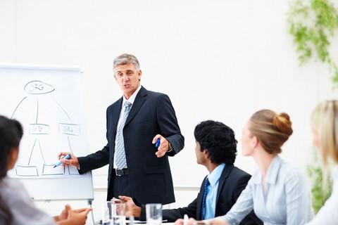 Man chairing a meeting