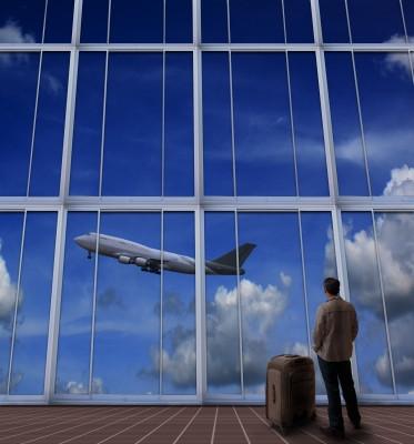 Man watching plane take off