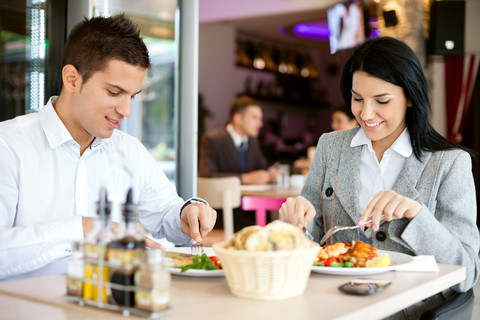 Business man and woman having a business lunch