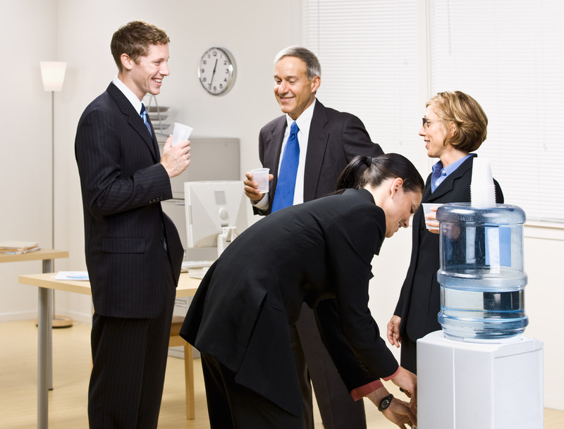 Business people around a water cooler