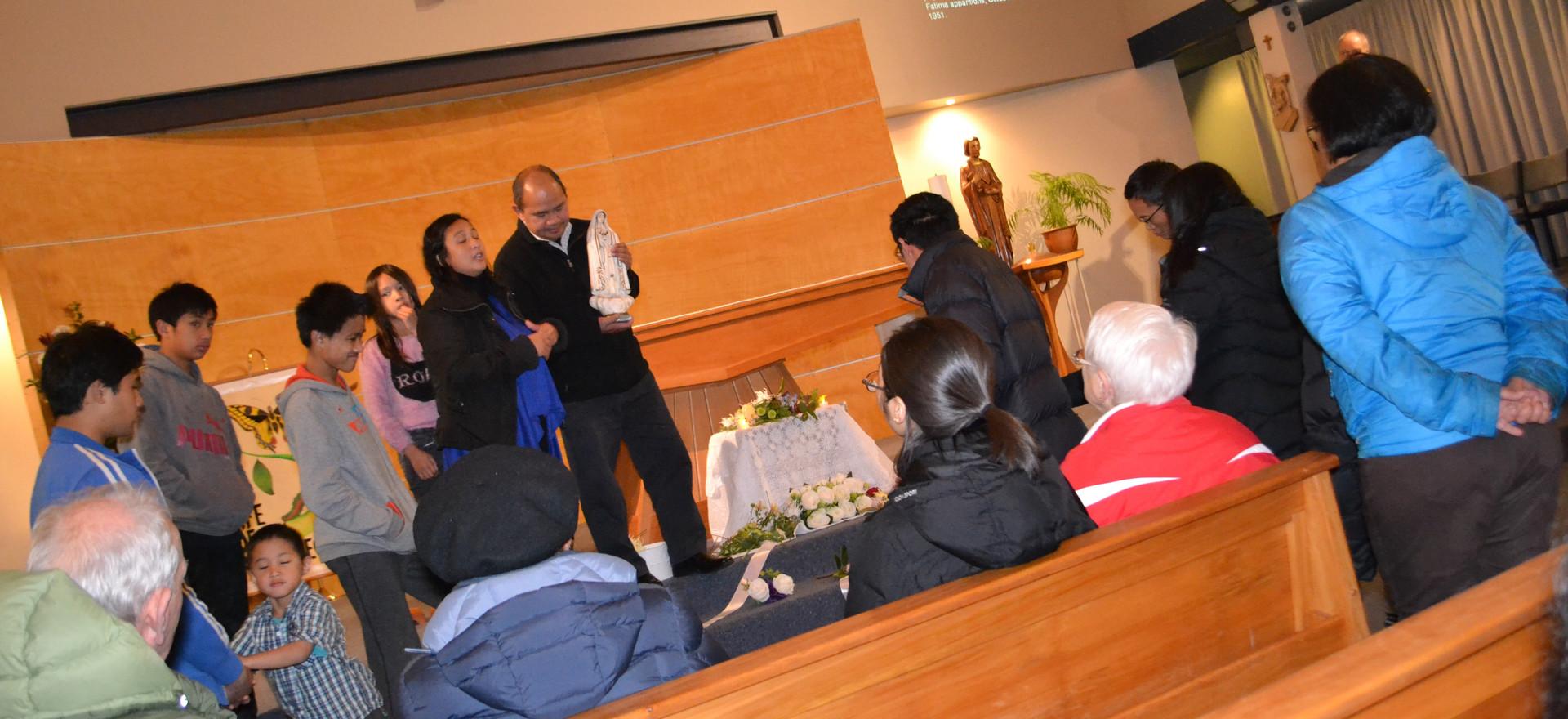 Sison Family passing on pilgrim statue t
