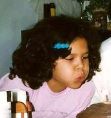 Me with weird side bangs pulled back with a barrette