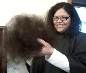 Me holding a tumbleweed of hair