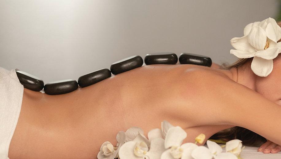Woman getting a hot stone massage at spa salon__edited_edited.jpg