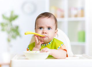 When is the best time to introduce solid foods to my baby?