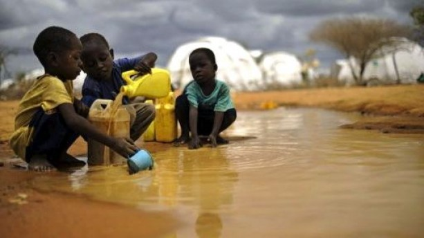 Somali-boys-fetch-water-after-rainfall-at-the-IFO-2-complex-of-the-sprawling-Dad