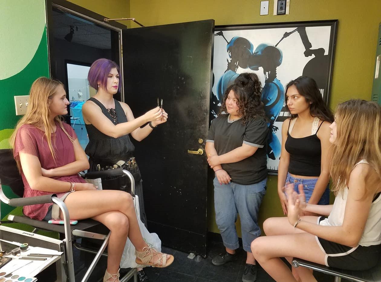 Diana teaches campers makeup