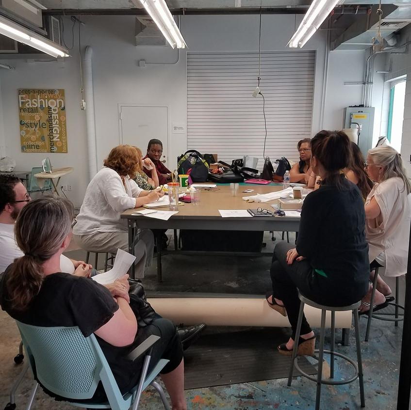Designer meeting in sewing room
