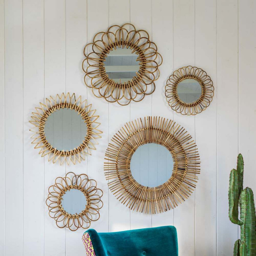 RATTAN WALL MIRRORS A beautiful collection of hand-woven Rattan Wall Mirrors. An instant classic