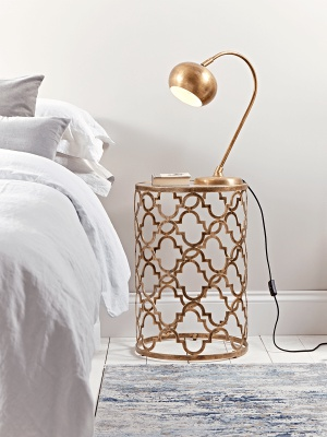 Curved brass table lamp. table lamp. interior design bedroom. home decor bedroom lighting